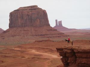 Navajo man posing with his horse.